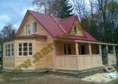 Дом из бруса с эркером, мансардой и крыльцом